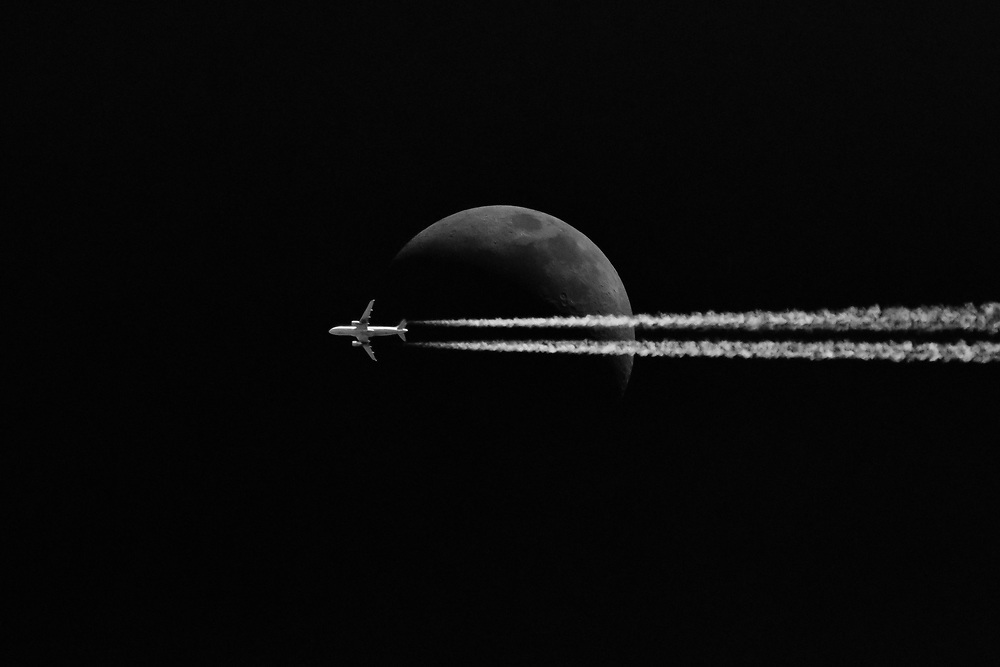 United Airlines flight 1710 (UAL1710), an A320, crosses the face of the moon at FL370 enroute from Fort Myers, FL (RSW) to Newark, NJ (EWR) on Wednesday afternoon, April 12, 2019.