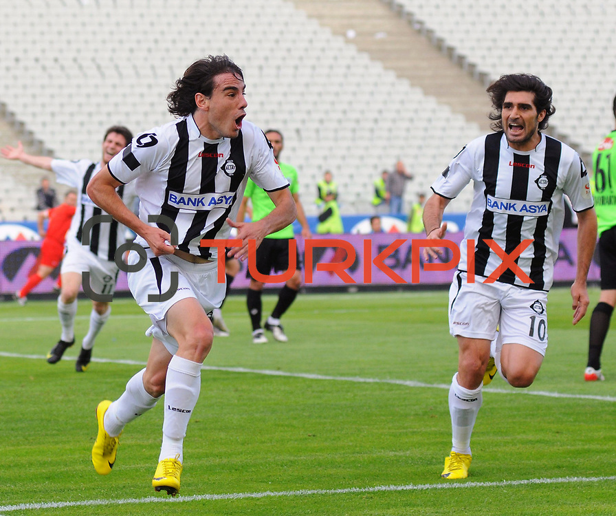 Altayspor's Jorge Emanuel MOLINA (L) celebrate his goal with Sehmus OZER (R) during their Turkish soccer Play Off final match Altayspor between Konyaspor at Ataturk Olympic Stadium in Istanbul Turkey on Sunday, 23 May 2010. Photo by TURKPIX