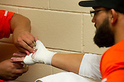 Johny Hendricks has his hands wrapped before his title fight against Robbie Lawler at UFC 171 in Dallas, Texas on March 15, 2014.