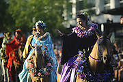 The Kau-Lio Pau Riders of Hawaii wave to the crowd in the 2011 Alaska Airlines Seafair Torchlight Parade in Seattle Saturday, July 30, 2011.<br /> <br /> Joel Hawksley / The Seattle Times
