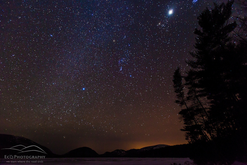 The night sky over Eagle Lake in Maine's Acadia National Park. Winter.