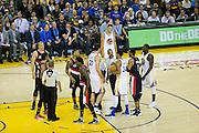 Refs break up a Golden State Warriors and Portland Trail Blazers get in a tussle at Oracle Arena in Oakland, Calif., on October 21, 2016. (Stan Olszewski/Special to S.F. Examiner)