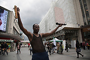 Man showing his specific religious beliefs in the public outdoor space at the Bullring in Birmingham, United Kingdom. The Bullring is a major commercial area of central Birmingham. It has been an important feature of Birmingham since the Middle Ages, when its market was first held. Two shopping centres have been built in the area in the 1960s, and then in 2003 the latter is styled as one word, Bullring.