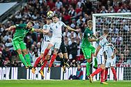 England (6) John Stones, England (5) Gary Cahil, Slovenia (5)Bosijan Cesar during the FIFA World Cup Qualifier match between England and Slovenia at Wembley Stadium, London, England on 5 October 2017. Photo by Sebastian Frej.