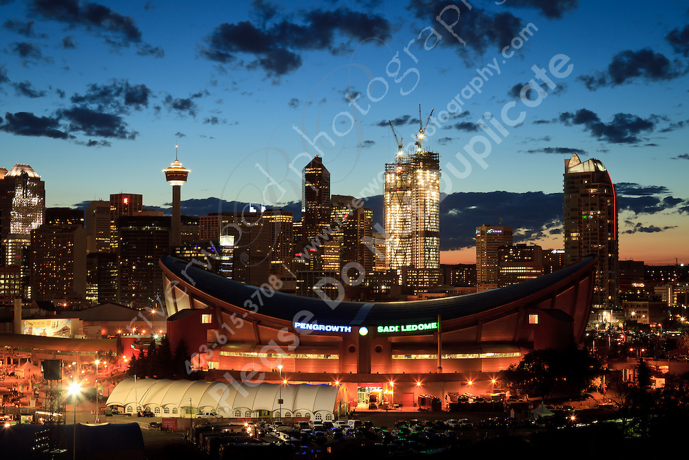The Calgary Saddledome and the skyline at night.<br /> <br /> ©2010, Sean Phillips<br /> http://www.RiverwoodPhotography.com