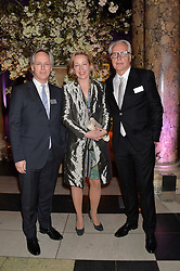 Left to right, SIR PAUL JONES and MR & MRS MARTIN (HARRIET) ROTH at a VIP preview of the V&A's new exhibition 'The Glamour of Italian Fashion' - a comprehensive look at Italian Fashion from 1945-2014 held at The Victoria & Albert Museum, London on 2nd April 2014.