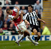 Fotball<br /> Photo. Jed Wee, Digitalsport<br /> NORWAY ONLY<br /> Newcastle United v Arsenal, FA Barclaycard Premiership, St James' Park, Newcastle. 11/04/2004.<br /> Arsenal's Thierry Henry (L) takes evasive action from Newcastle's Aaron Hughes.