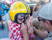 Maggie Holland, 5, gets some help from dad Tim as she suits up for the Mini Figure 8 Race at Teton County Fair's main event Sunday night. A handful of youngsters competed in the first ever junior division race to the roar of the audience at the Figure 8 Races.