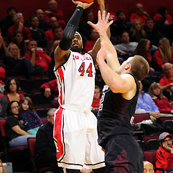 J.J. Moore #44 of the Rutgers Scarlet Knights takes a shot over Dalton Pepper #32 of the Temple Owls during the second half of Rutgers men's basketball vs Temple Owls in American Athletic Conference play on Jan. 1, 2014 at Rutgers Louis Brown Athletic Center in Piscataway, New Jersey.