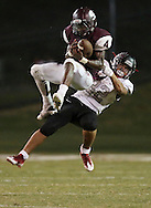 Sherman's Brayshon Savage grabs an interception in front of Liberty's Dimitri Jones in the fourth quarter of a game between Sherman High and Frisco Liberty on Friday, Sept. 2, 2016 at Bearcat Stadium in Sherman.  (Kevin Bartram/www.buzzzphotos.com)