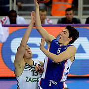 Anadolu Efes's Cedi Osman (R) and Zalgiris Kaunas's Paulius Jankunas (L) during their Turkish Airlines Euroleague Basketball Group A Round 3 match Anadolu Efes between Zalgiris Kaunas at Abdi ipekci arena in Istanbul, Turkey, Thursday, October 30, 2014. Photo by Aykut AKICI/TURKPIX