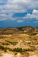 Painted Canyon Panorama. Theodore Roosevelt National Park. Image taken with a Nikon D3 and 85 mm f/2.8 PC-E lens (ISO 200, 85 mm, f/16, 1/40 sec). 8 of 9 images combined with AutoPano Giga and Dehaze Filter.