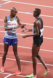 London, August 12 2017 . Mo Farah, Great Britain, and Mohammed Ahmed, Canada, congratulate each other after the men's 5000m final on day nine of the IAAF London 2017 world Championships at the London Stadium. © Paul Davey.