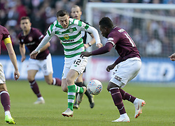 Heart of Midlothian's Danny Amankwaa (right) battle for the ball with Celtic's Callum McGregor (left) during the Betfred Cup semi final match at BT Murrayfield Stadium, Edinburgh.