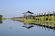 Burma/Myanmar, Inle Lake. The teakwood footbridge connecting two parts of Maing Thauk village - the one set on dry land with the other half which is sat on stilts over the water of Inle Lake.