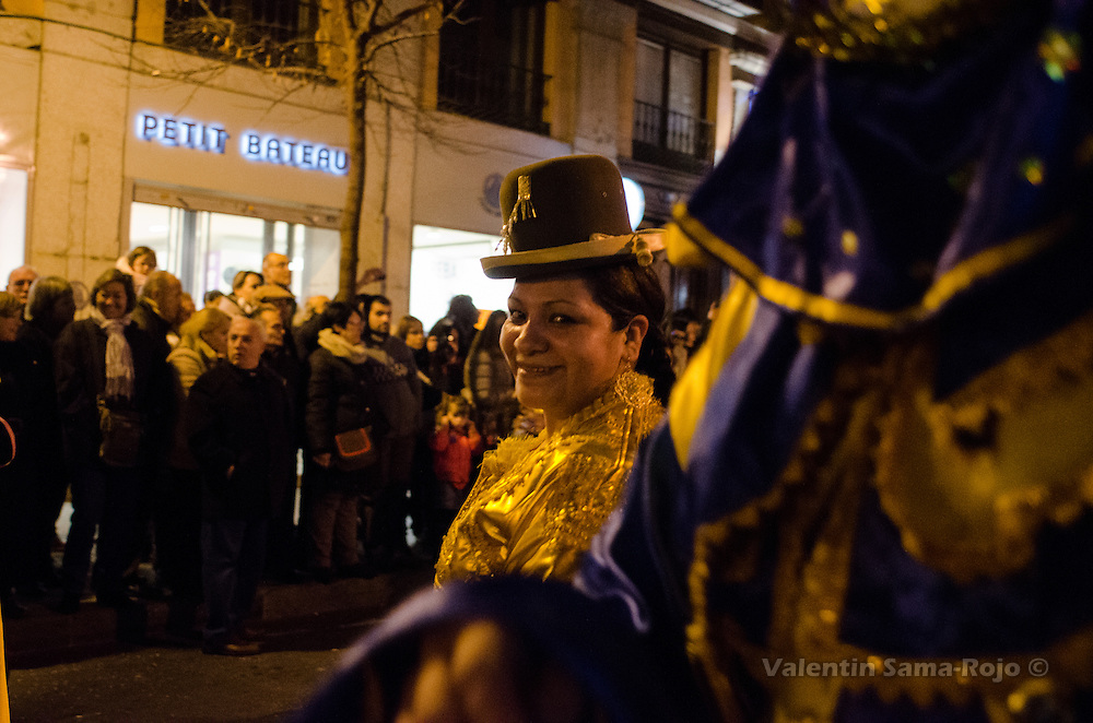 Woman with traditional dress from Bolivia smilling to the camera menwhile she dance at Madrid's carnival parade.