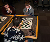 Johnny Spencer ponders his next move with opponent Nemanja Boskivic both from Laconia High School during the City Wide Chess Tournament at Huot Technical Center on Saturday morning.  (Karen Bobotas/for the Laconia Daily Sun)
