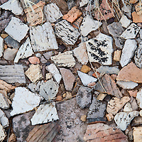 021913       Brian Leddy<br /> Shards of pottery and other artifacts litter the ground near a ruins complex at Fort Wingate.