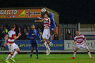 AFC Wimbledon defender Paul Kalambayi (30) winning header during the The FA Cup match between AFC Wimbledon and Doncaster Rovers at the Cherry Red Records Stadium, Kingston, England on 9 November 2019.