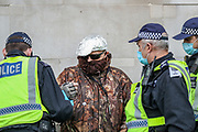 Police detain a protestor during anti-lockdown protests in London on Saturday, Oct 24, 2020. Protestors gathered for a march through central London, a change in approach after police used forced to break up the last two anti-lockdown demonstrations in Trafalgar Square. Territorial Support Group police force was deployed to Trafalgar Square and Westminster Bridge as police attempted to disperse anti-lockdown protesters. (VXP Photo/ Vudi Xhymshiti)