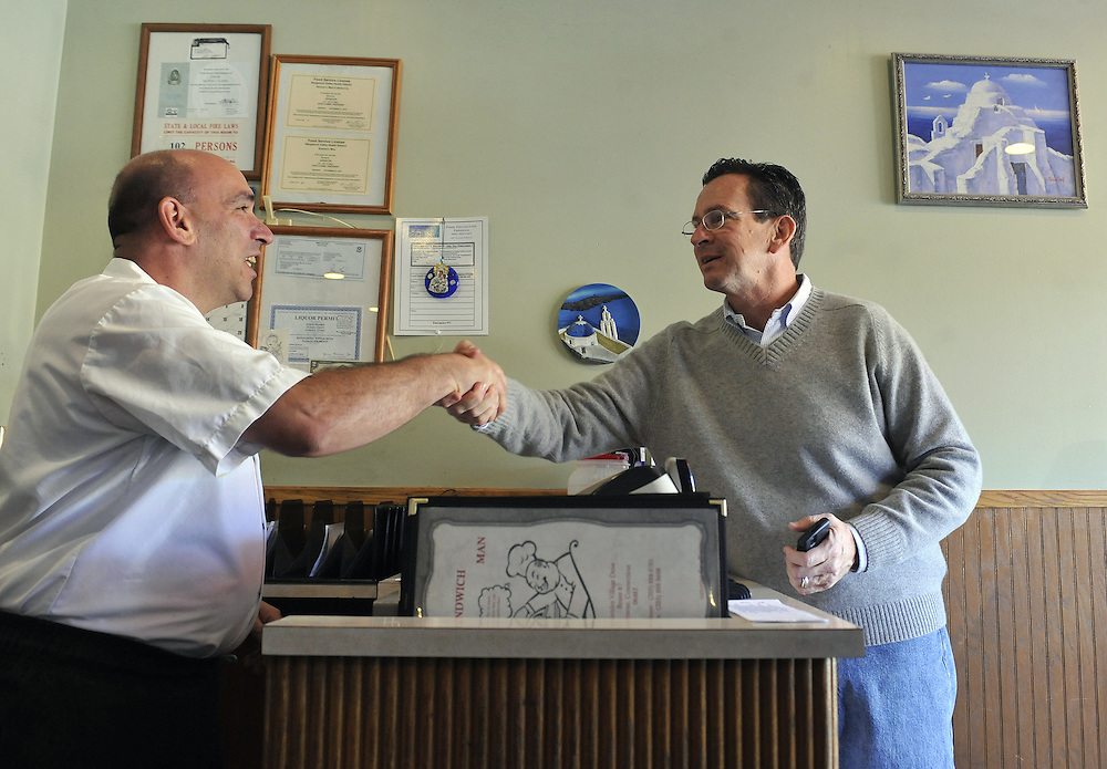 Democratic gubernatorial candidate Dan Malloy, right, shakes hands with John Vlamis, owner of The Sandwich Man restaurant, while campaigning, Monday, Nov. 1, 2010, in Seymour, Conn. (AP Photo/Jessica Hill)
