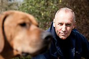 Swedish writer Håkan Nesser photographed in London. Nesser in Holland Park with his dog Norton.