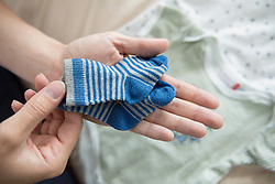 Close-up woman hands holding baby socks