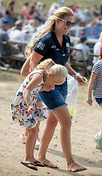 Autumn Phillips walks with her daughter Isla on the second day of the Festival of British Eventing at Gatcombe Park, Gloucestershire.