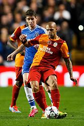 Galatasaray Midfielder Felipe Melo (BRA) is challenged by Chelsea Midfielder Oscar (BRA) - Photo mandatory by-line: Rogan Thomson/JMP - 18/03/2014 - SPORT - FOOTBALL - Stamford Bridge, London - Chelsea v Galatasaray - UEFA Champions League Round of 16 Second leg.