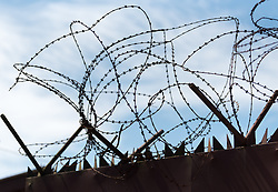3 November 2019, Monrovia, Liberia: Barbed wire on the gate into the Christ the King Parish compound in Monrovia.