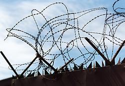 3 November 2019, Monrovia, Liberia: Barbed wire on the gate into the Christ the King Parish compound in Monrovia.