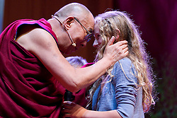 © Licensed to London News Pictures. 16/06/2012. Manchester , UK . The Dalai Lama blesses Kila Curran Coleman, 13, from County Limerick in the Republic of Ireland . She won an award for forgiveness. Her father  , Pat Coleman , was murdered in Limerick six years ago in an unprovoked attack and she wrote a letter of forgiveness to her father's killer . The Dalai Lama at the Manchester Arena , Greater Manchester , at the Stand Up and Be the Change youth event . The Dalai Lama is on a 10 day tour of the UK . Photo credit : Joel Goodman/LNP