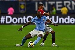 Manchester City midfielder Fernandinho (25) gets around Manchester United midfielder Jesse Lingard (14) during play a the International Champions Cup match between Manchester United and Manchester City at NRG Stadium in Houston, Texas
