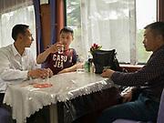 Man drink alcolhol in the train from Hong Kong to Urumqi, Xinjiang.