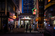 Hong Kong - August 21, 2019: Night scene outside an entrance to Hong Kong Station on Des Voeux Road Central on Hong Kong Island.