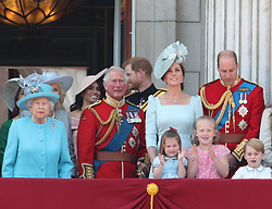 (left to right) Queen Elizabeth II, Duchess of Sussex, Prince of Wales, Duke of Sussex and the Duke and Duchess of Cambridge with Princess Charlotte, Savannah Phillips and Prince George, on the balcony of Buckingham Palace, in central London, following the Trooping the Colour ceremony at Horse Guards Parade as the Queen celebrates her official birthday.