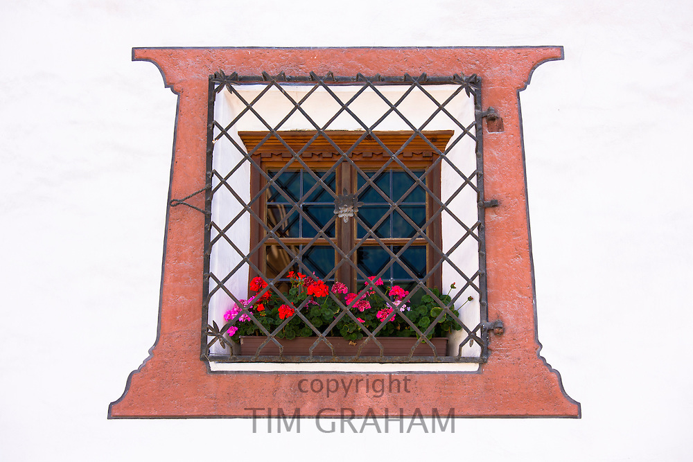 Window detail of traditional old 18th Century Tyrolean house in the town of Oetz in the Tyrol, Austria