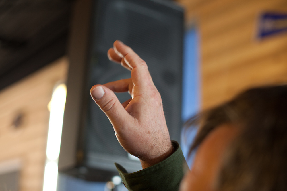 A man raises his hand during a Q & A period with Rick Santorum as he made his way through the Upstate in South Carolina.