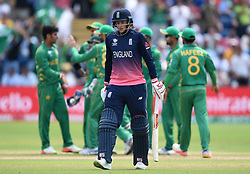 England's Joe Root shows his dejection as he leaves the field after being dismissed for 46 during the ICC Champions Trophy, semi-final match at the Cardiff Wales Stadium.