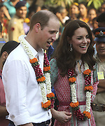 April 10, 2016 - Mumbai, INDIA - <br /> <br /> Britain's Prince William, and his wife Kate, the Duchess of Cambridge, talk to children during their visit to a slum in Mumbai, India, Sunday, April 10, 2016. The royal couple began their weeklong visit to India and Bhutan, by laying a wreath at a memorial Sunday at Mumbai iconic Taj Mahal Palace hotel, where 31 victims of the 2008 Mumbai terrorist attacks were killed. <br /> ©Exclusivepix Media