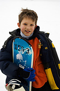 Portrait of young boy snowboarder Model release 2612
