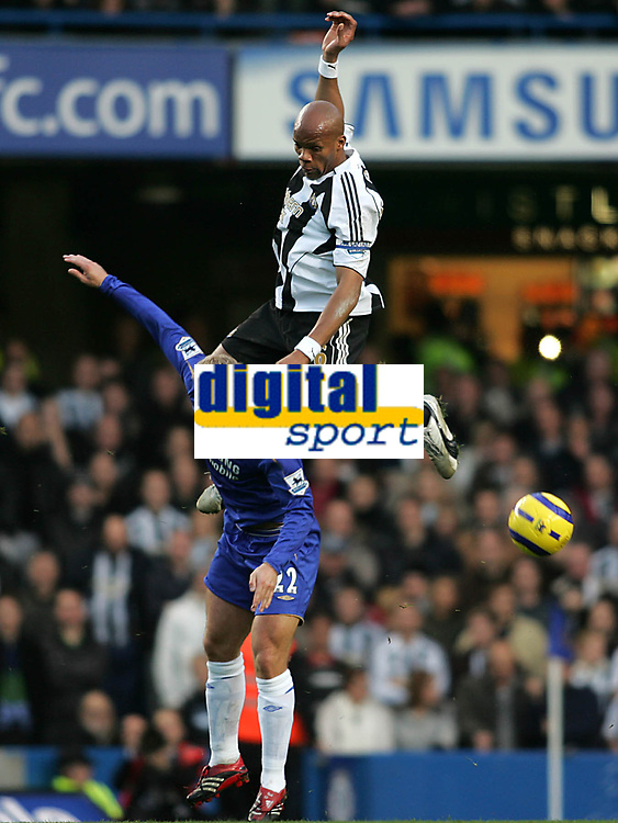 Photo: Lee Earle.<br /> Chelsea v Newcastle United. The Barclays Premiership.<br /> 19/11/2005. Chelsea's Eidur Gudjohnsen (L) clashes with Jean-Alain Boumsong.