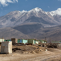 View on the settlements out of the city of Arequipa with 6057 m high Chachani Volcano in the back.
