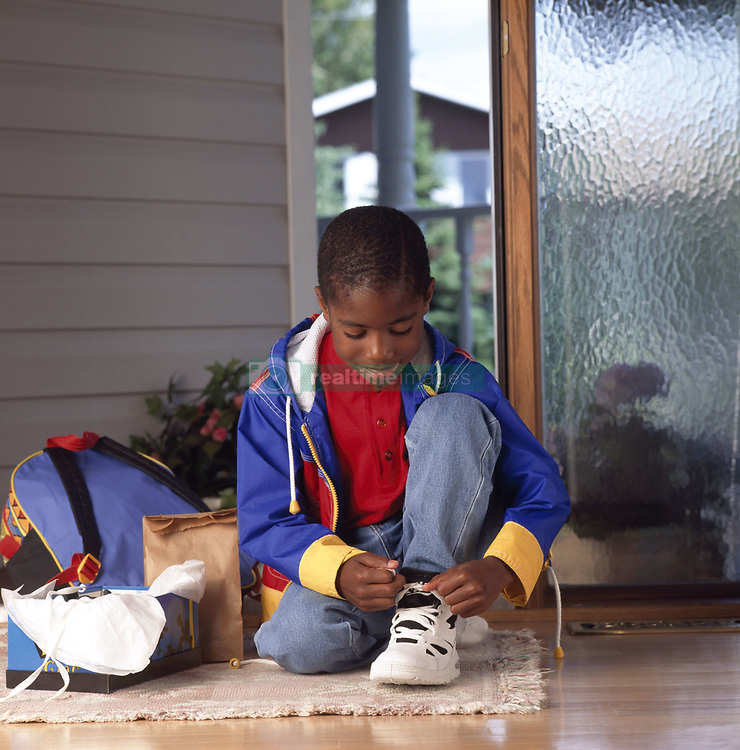 July 21, 2019 - Boy Tying His Shoes (Credit Image: © Ron Nickel/Design Pics via ZUMA Wire)
