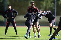 13 September 2017 -  UEFA Europa League (Group H) - Arsenal Training - Olivier Giroud wrestles with Mohamed Elneny of Arsenal - Photo: Marc Atkins/Offside