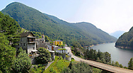 Para gliders over the rustic alpine village of Vogorno with lake Vogorno, Val Verzasca, Tocino Switzerland