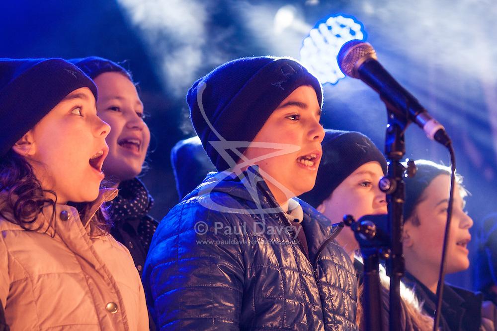 Trafalgar Square, London, December 16th 2014.  London's Jewish community celebrates Chanukah in the Square which marks the beginning of the Jewish festival of lights. The annual event is presented by the Jewish Leadership Council, London Jewish Forum and Chabad and is supported by the Mayor of London.  PICTURED: The Akiya School children's choir entertains the crowd.