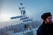 The Pole of Cold. Visitor at the Pole of Cold monument in the village of Oymyakon - it is said that the lowest temperature ever here was -71.2°C. The area is extremely cold during the winter. Two towns by the highway, Tomtor and Oymyakon, both claim the coldest inhabited place on earth (often referred to as -71.2°C, but might be -67.7°C) outside of Antarctica. The average temperature in Oymyakon in January is -42°C (daily maximum) and -50°C (daily minimum). The images had been made during an outside temperature in between -50°C up to -55°C. Oymyakon, Oimjakon, Yakutia, Jakutien, Russian Federation, Russia, RUS, 20.01.2010