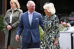 © Licensed to London News Pictures. 27/05/2021. London, UK. HRH The PRINCE OF WALES and The DUCHESS OF CORNWALL visit Old Clapham Town to celebrate the High Street and retail sector as non-essential shops reopen and Coronavirus restrictions ease. THIS PHOTO IS EMBARGOED FOR USAGE UNTIL 13:00 27/05/2021. Photo credit: London News Pictures