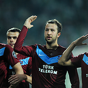 Trabzonspor's Remzi Giray KACAR (C) and Gustavo COLMAN (R) during their Turkish soccer superleague match Bursaspor between Trabzonspor at Ataturk Stadium in Bursa Turkey on Saturday, 22 October 2011. Photo by TURKPIX